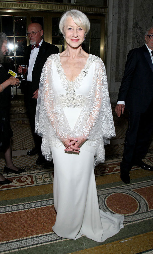 Lovely in lace, Helen Mirren attended the 2015 Tony Awards in a white Badgley Mischka gown featuring sheer lace cape sleeves and embellishments around the waist and neckline.