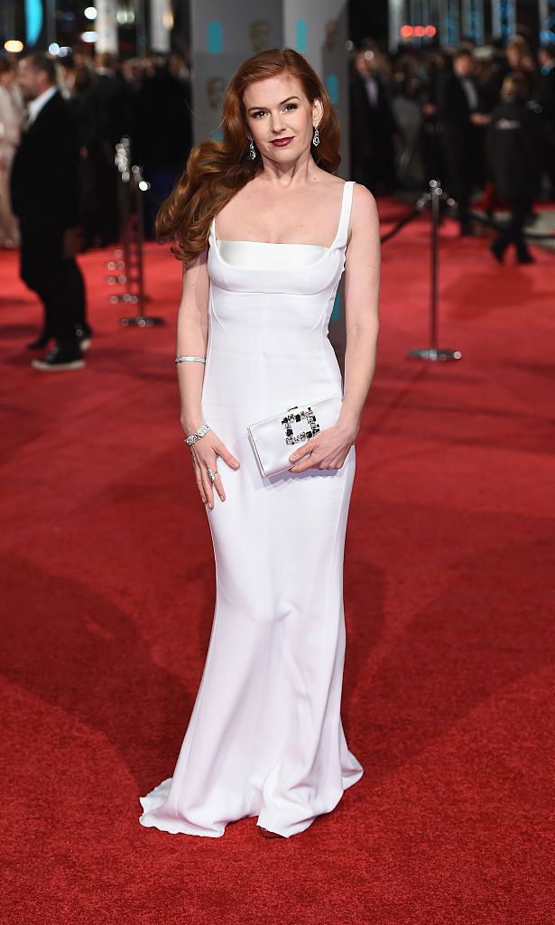 Isla Fisher channeled old Hollywood at the 2016 BAFTAs donning a form-fitting Stella McCartney silk gown with detailing at the bust.