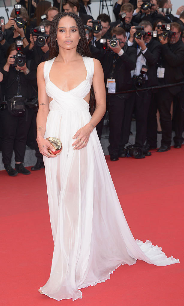Zoe Kravitz turned heads at the 2014 Cannes Film Festival premiere of <em>Mad Max : Fury Road</em> wearing a sheer, flowing Valentino gown.