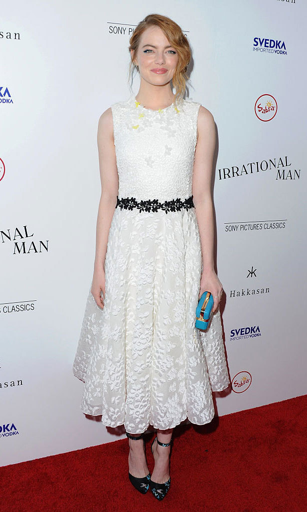 Emma Stone looked charming in an a-line midi dress by Giambattista Valli featuring floral detailing and a black embroidered belt at the waist to the Los Angeles premiere of <em>Irrational Man</em> in 2015