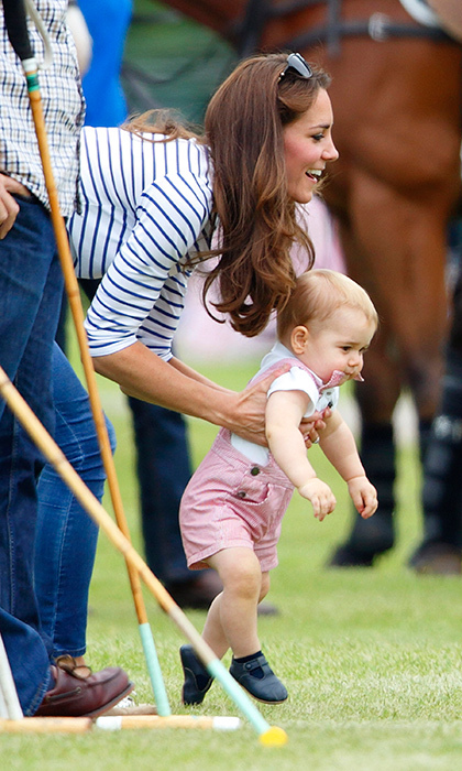 It was all fun and games for Kate and George when they took in a charity polo match in Cirencester, England. Among the many players raising funds for good causes were George's dad the Duke of Cambridge and his uncle Prince Harry.