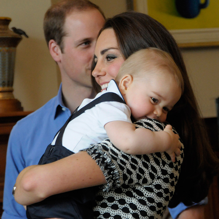 And baby makes three! The Duchess of Cambridge was all smiles as she cuddled up to Prince George during the family's visit to Government House in New Zealand.