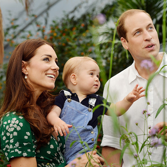 This photo of curious George in action was released just before the future monarch's first birthday. Safe in his mother's arms, the royal tot can be seen reaching out to butterflies beyond the frame at a special exhibit at London's Natural History Museum.
