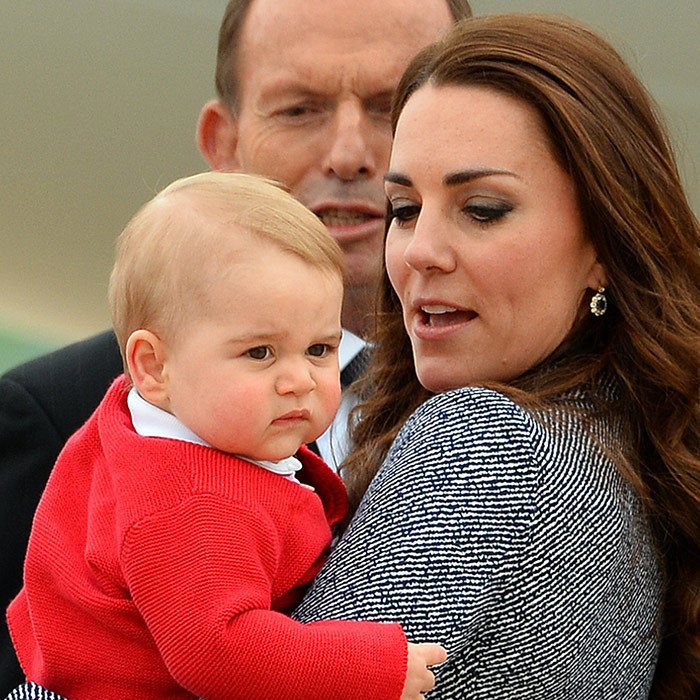 Kate had a hard time hiding a smile when George showed off his grumpy face at the airport in Australia during the family's three-week tour in 2013.