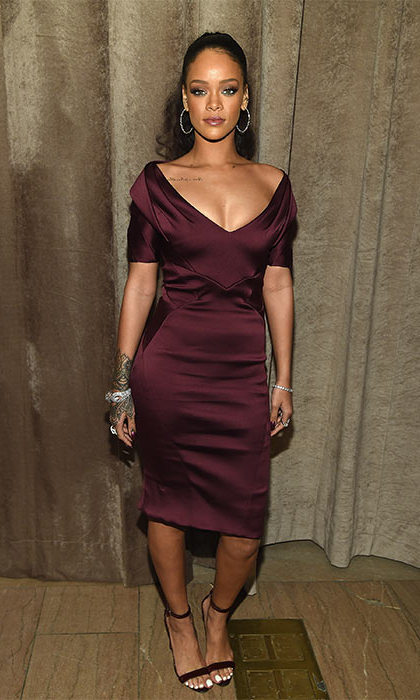 Flaunting her curves in a gorgeous wine coloured dress. 