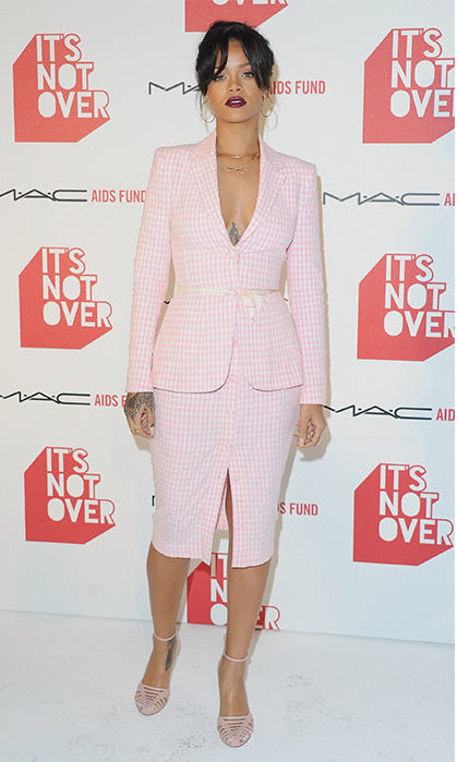 Proving she can do formal in a cute pink skirt suit. 