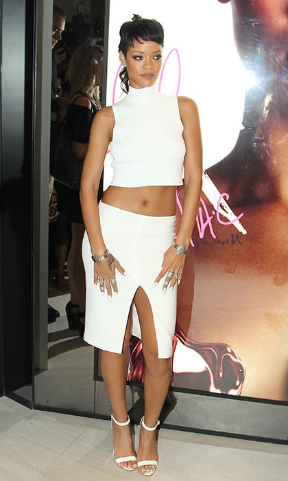 It's a big deal when you launch your own MAC lipstick - and Rihanna flashed the flesh in a white crop top and matching midi skirt. 