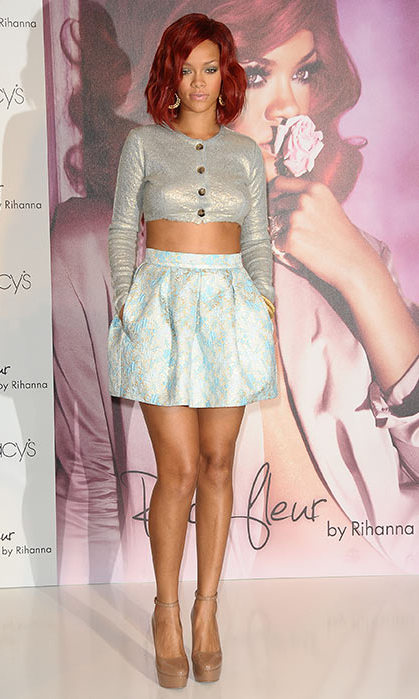 At the launch of her debut fragrance, Rihanna looked demure in a crop top and skirt. 