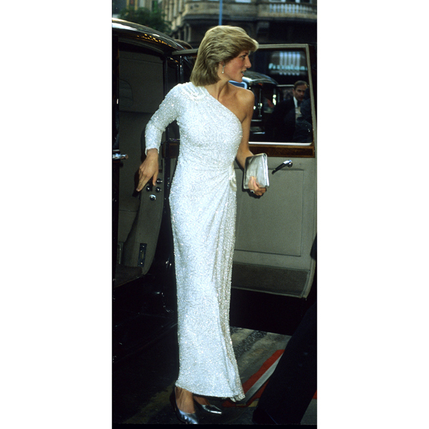 "Back in 1983, the style icon shined in a heavily beaded one-shoulder look by <strong><a href=""/tags/0/hachi"">Hachi</a></strong> as she and Prince Charles attended the London premiere of <em>Octopussy</em>.