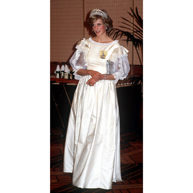 "Looking every inch the Disney princess, this 1983 taffeta and lace look by <strong><a href=""/tags/0/gina-fratini"">Gina Fratini</a></strong> was perfectly paired with the <strong><A href=""/tags/0/lovers-knot-tiara"">Cambridge Lovers' Knot Tiara</strong></a>, a family heirloom designed by <strong>Queen Mary</strong> and later worn by <strong><a href=""/tags/0/kate-middleton"">Duchess Kate</a></strong> many times since 2011. 
