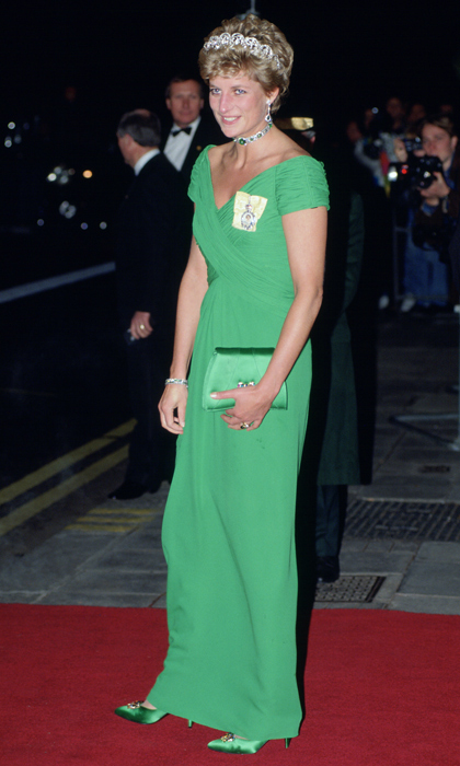"Princess Diana had fans green with envy as she walked the red carpet at the Dorchester Hotel in a ruched <strong><a href=""/tags/0/catherine-walker"">Catherine Walker</a></strong> gown with matching accessories. She topped off the look with the family order pinned near her neckline.
