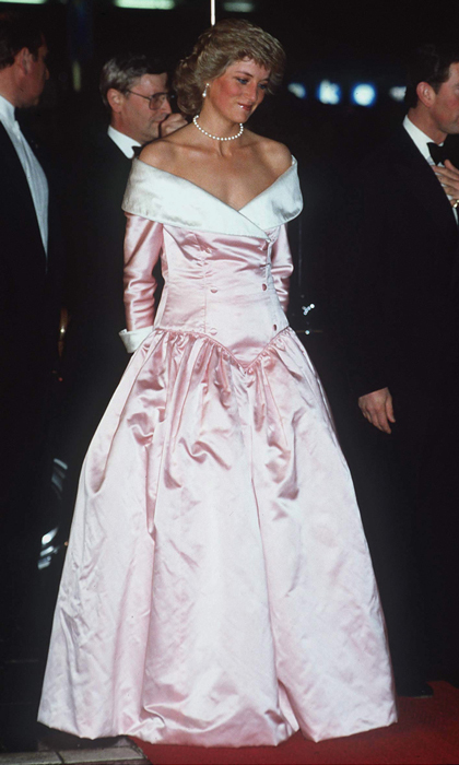 "Princess Diana slipped into yet another <strong><a href=""/tags/0/catherine-walker"">Catherine Walker</a></strong> design – a pale-pink ball gown with a tuxedo-style off-the-shoulder neckline – for a performance by the Royal Ballet at the Berlin Opera House. 