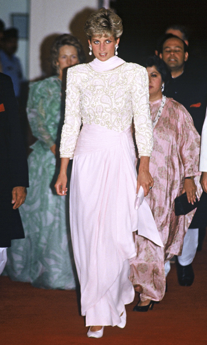 While attending a reception in her honour in Lahore, Pakistan in 1991, Diana took a style cue from her host country in a sari-inspired pink gown with a matching neck scarf and beaded paisley bodice.