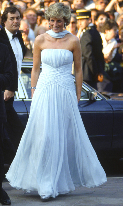 "A glamorous appearance at Cannes was one for the books as Diana practically floated down the red carpet in a whimsical, Grecian-style, silk chiffon gown by <strong><a href=""/tags/0/catherine-walker"">Catherine Walker</a></strong>. The pale-blue hue emphasized her olive complexion and the strapless neckline showed off her decolletage. 