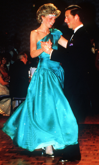 "The princess danced up a storm in this one-shoulder turquoise creation by <strong><a href=""/tags/0/david-emanuel"">David Emanuel</a></strong> at the Southern Cross Hotel during her tour of Australia in 1985. The adventurous fashionista paired her stunning gown with an emerald and diamond headband.