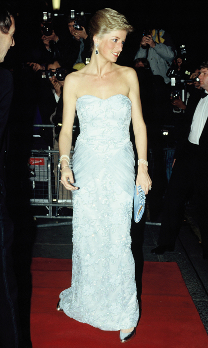 "Diana called on this strapless <strong><a href=""/tags/0/catherine-walker"">Catherine Walker</a></strong> gown for a performance of <i>Moulin Rouge</i> at the Savoy Hotel in 1989. She paired the light-blue gown with a matching clutch and silver stilettos. 