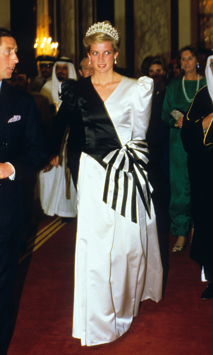 "To greet the visiting Crown Prince of Saudi Arabia in 1986, Diana dazzled in a black and white gown by the <strong><a href=""/tags/0/david-and-elizabeth-emanuel"">Emanuels</a></strong>. The only thing more eye-catching than the gown's large striped bow is the princess's diamond-encrusted tiara. 