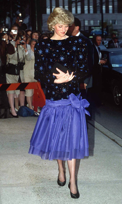 "Diana looked out-of-this-world in a starry midnight-blue drop-waisted dress with velvet bodice by <strong><a href=""/tags/0/jacques-azagury"">Jacques Azagury</a></strong> while visiting Vancouver in 1986. 