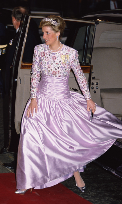 "With the Spencer family tiara on display for all to see, Diana dashed in to a state banquet at London's Claridge's Hotel in a floral and lavender gown by <strong><a href=""/tags/0/catherine-walker"">Catherine Walker</a></strong>. 