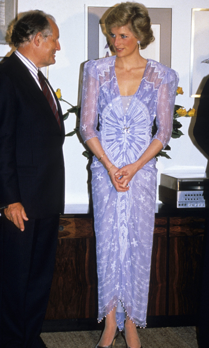 "In 1989, the royal looked marvellous in a purple printed <strong><a href=""/tags/0/zandra-rhodes"">Zandra Rhodes</a></strong> cocktail dress while mingling at the British Consulate in Dubai. 