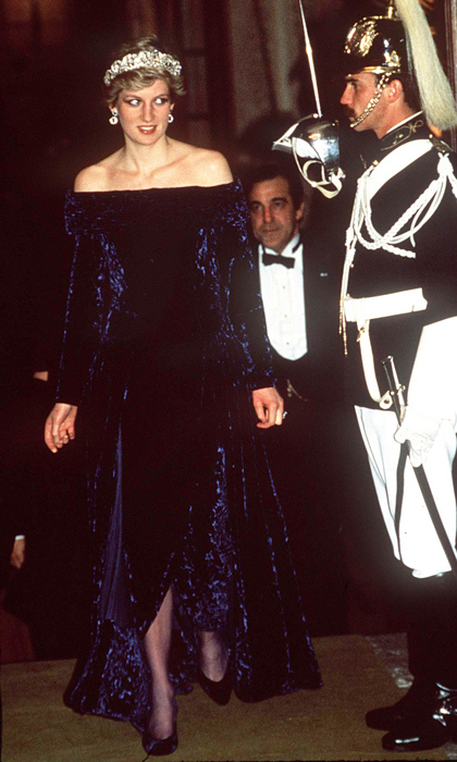 "In 1987, Diana's had everyone standing at attention at the Ajuda Palace in Portugal thanks to this crushed-velvet gown by <strong><a href=""/tags/0/bruce-oldfield"">Bruce Oldfield</strong></a>.