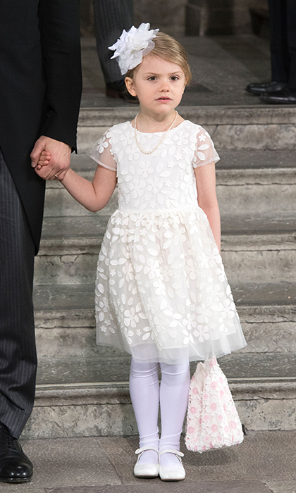 May 2016: Big sister Estelle was on her best behaviour at Prince Oscar's christening on May 27. The little princess looked adorable in a floral-printed dress which she perfectly accessorized with a sequined purse and flower fascinator. 