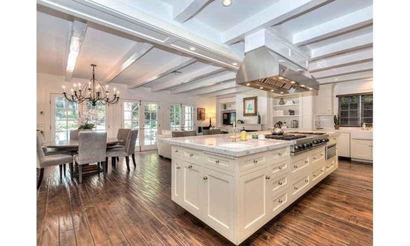 An open-concept kitchen and large island is the perfect space for cooking up a feast. 