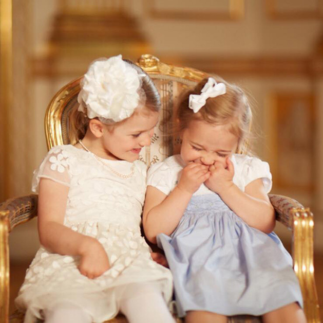 Best friends Princess Estelle and Princess Leonore giggle during a portrait session following Estelle's little brother Prince Oscar's christening on May 27, 2016. The cousins' moms, Crown Princess Victoria and Princess Madeleine, are sisters. 