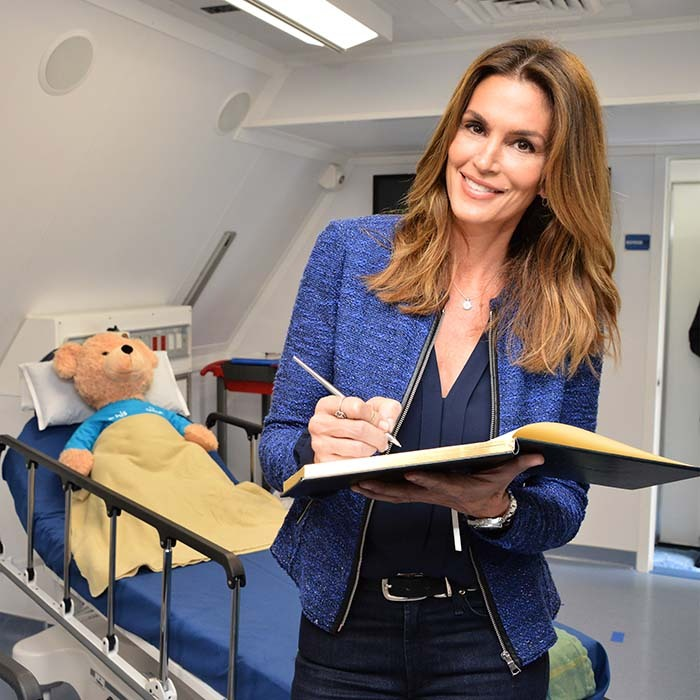 Mom-of-two Cindy Crawford unveiled Orbis's latest Next Generation Flying Eye Hospital, which helps deliver medical products and care to the blind.