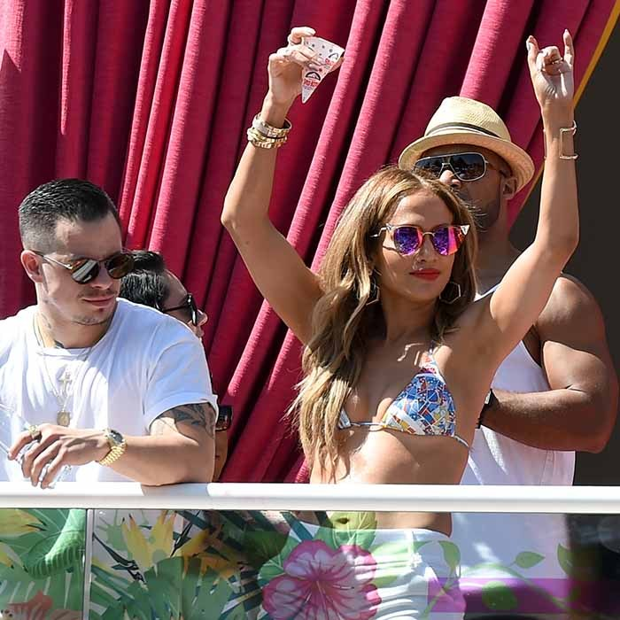 "Jennifer Lopez and her choreographer boyfriend Casper Smart partied it up at Drai's Beach Club's ""Carnival Del Sol"" pool party in Las Vegas. 