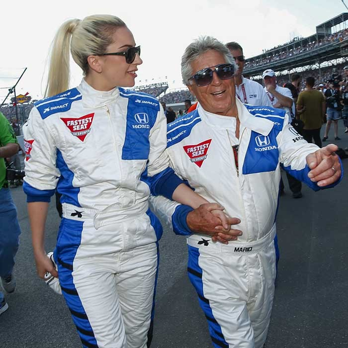 A race-ready Lady Gaga took a spin with racing legend Mario Andretti at the Indy 500. 