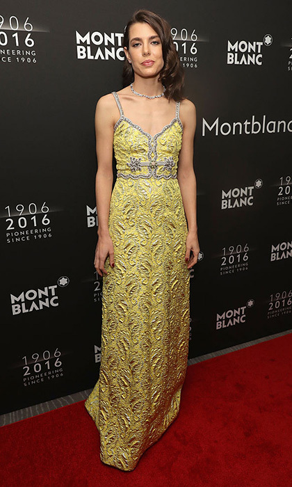 Charlotte Casiraghi is the picture of elegance in a golden toned brocade gown.