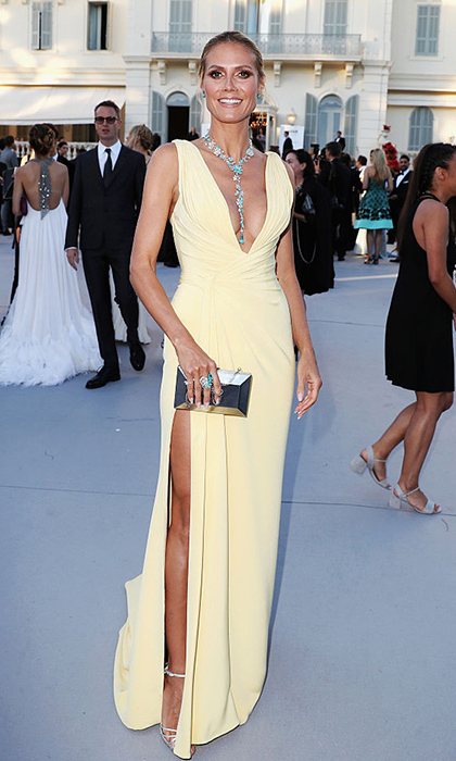 Heidi Klum glammed it up in Atelier Versace and turquoise Lorraine Schwartz jewels at the amfAR gala in Cannes.
