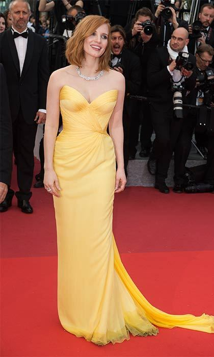 A sunny strapless corset gown highlights Jessica Chastain's hourglass figure.