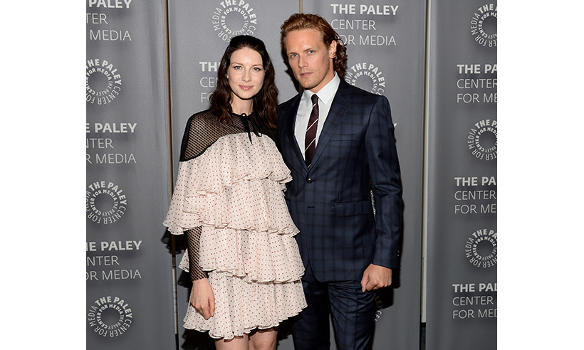<i>Outlander</i> stars Caitriona Balfe and Sam Heughan attended the opening of the exhibit. 