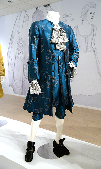 The exhibit showcases fashions worn by the men in King Louis XV's court. 