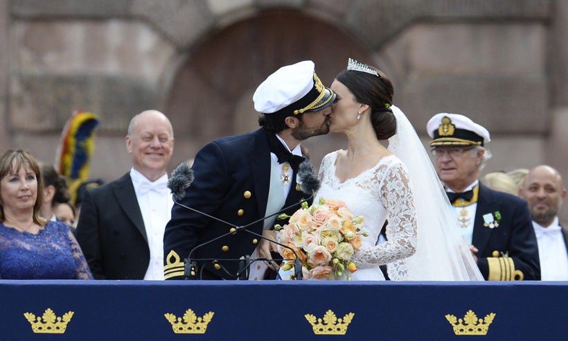 Sealed with a kiss! The newlyweds shared several kisses as they celebrated their union with well wishers who had lined the streets. 