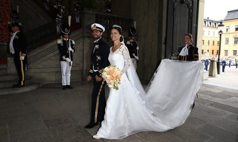 The bride was radiant in a gown by Swedish designer Ida Sjöstedt. 