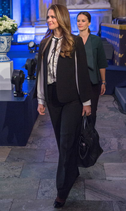 The royal flexed her fashion prowess in a trendy black cape paired with a ruffled white shirt with delicate black bow and black trousers at the Global Child Forum in November 2015. 