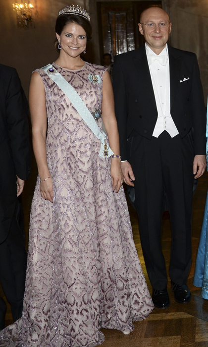 Just days before announcing her second pregnancy, Princess Madeleine attended the 2014 Nobel Banquet looking effortlessly ladylike in apatterned pink gown with a show-stopping tiara. 