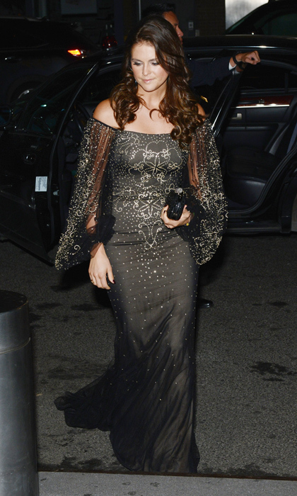 The London-based beauty went for goth glamour in an off-the-shoulder black gown embellished with metallic decals at the Farm to Fork Royal Gala award dinner in New York in 2012.