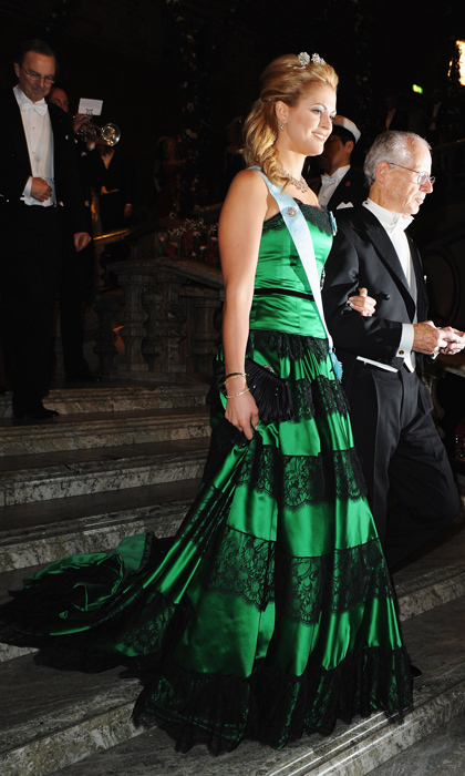 The then-blond beauty showed her love for vibrant hues at Stockholm's Nobel Foundation Prize Banquet in 2009, wearing an emerald-green gown with black lace accents. 