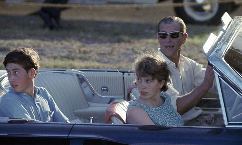 When his children were young, Philip loved to forgo a chauffeur and take control of the wheel. Here, he drives Prince Charles and Princess Anne to a polo match in Kingston, Jamaica. 
