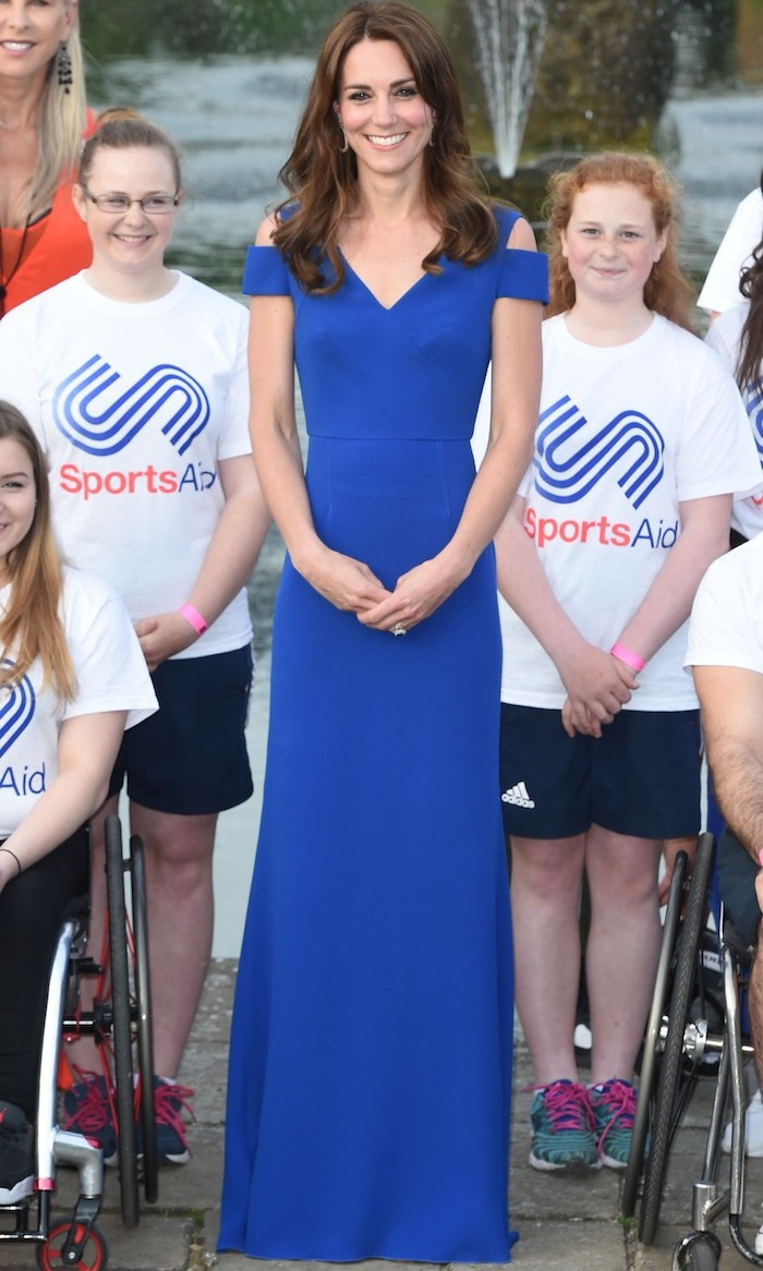 Clad in royal blue, Kate hosted an elegant dinner at Kensington Palace for SportsAid, a charity for which she is a patron. The royal wore a figure-hugging silhouette with cutout shoulders by Roland Mouret.