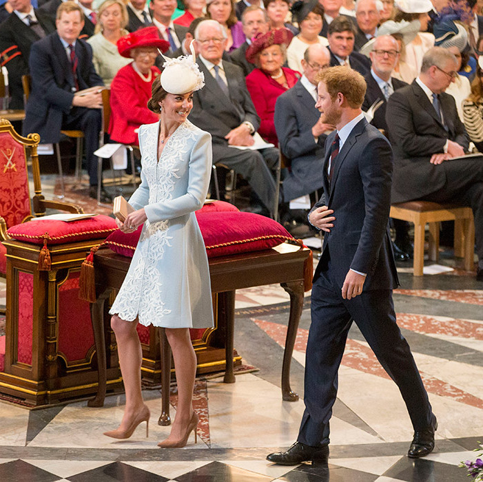Kate and Harry prepare to take their seats inside the cathedral.
