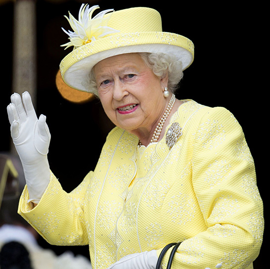 The Queen looked sunny in a yellow Angela Kelly coat and hat.