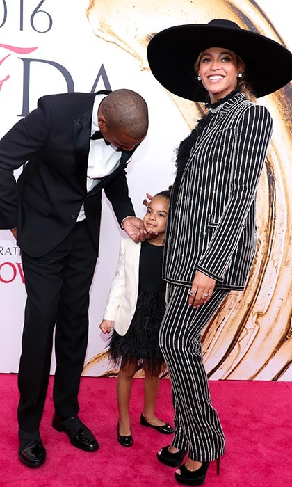 Beyoncé may have been crowned a Fashion Icon at the CFDAs, but it was her daughter Blue Ivy, seen here with dad Jay Z, that stole the show. 