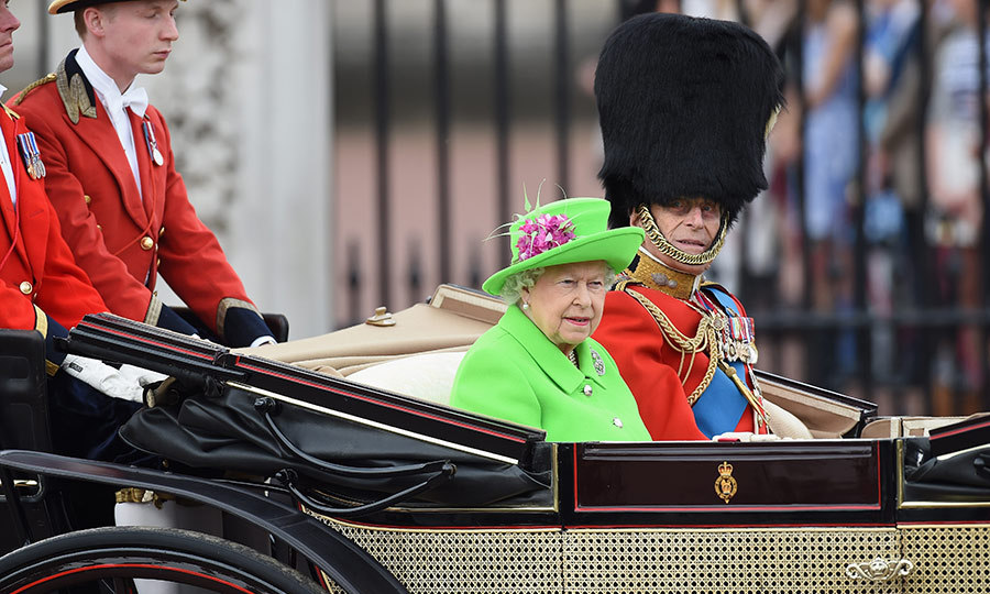 The Queen wore a vibrant green outfit by Stewart Parvin.