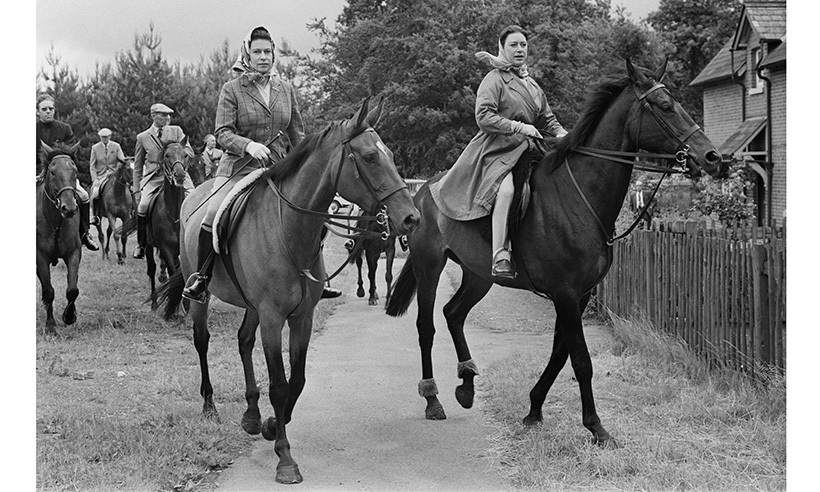 The Queen is a lifelong equestrian. Here, she rides at Ascot alongside Princess Margaret in 1969.