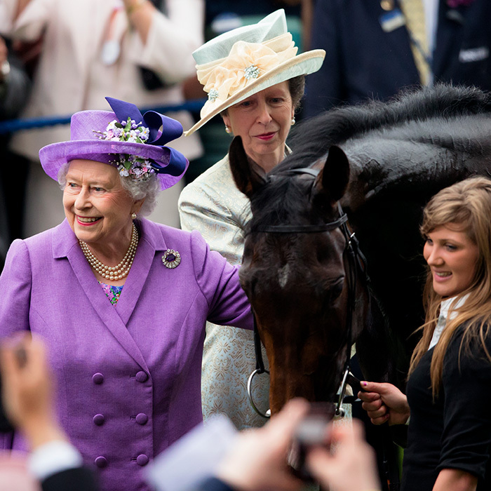 Hats off to the royal women on Ladies Day at Royal Ascot! In 2013, Princess Anne was by her mother's side as her horse Estimate became a champion. 